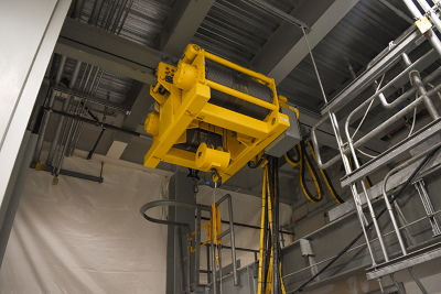 A 10-ton transfer hoist, located in the Hanford Site's Low-Activity Waste Facility, is a key component in moving containers filled with treated tank waste. During operations, the remotely operated hoist will function behind a shield door. Image: govdelivery.com