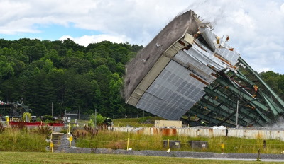 Crews use large winches to tear down a 180-foot tower of the Centrifuge Complex at Oak Ridge. Image: govdelivery.com